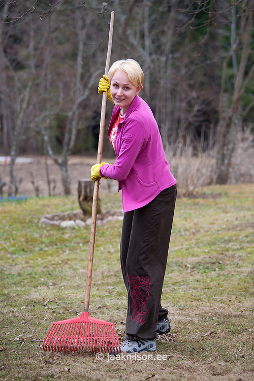Caucasian Woman Raking Leaves