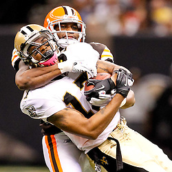 Oct 24, 2010; New Orleans, LA, USA; Cleveland Browns cornerback Sheldon Brown (24) tackles New Orleans Saints wide receiver Robert Meachem (17) during the second half at the Louisiana Superdome. The Browns defeated the Saints 30-17.  Mandatory Credit: Derick E. Hingle