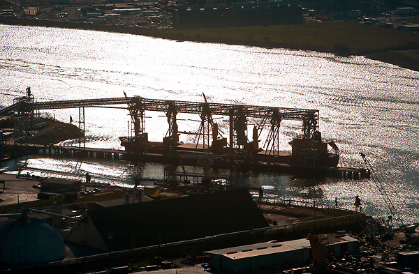 sunset aerial silhouette view of ships passing through the Port of Houston