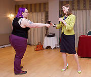 Stonewall and Liberal Democrats LGBTQ fringe meeting.<br /> Bournemouth, Great Britain <br /> 17th September 2017. <br /> <br /> Jennie Rigg passes a glass of red wine to <br /> <br /> Jo Swinson <br /> Deputy Leader of the Liberal Democrats <br /> <br /> Photograph by Elliott Franks <br /> Image licensed to Elliott Franks Photography Services