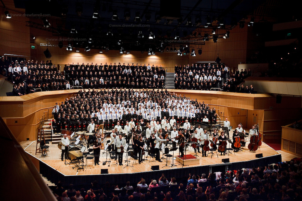 Over 650 singers from nine NYCoS Area Choirs throughout Scotland with the black shirts of the Changed Voice section of NYCoS National Boys Choir, conducted by Christopher Bell (pictured right) and joined by the Orchestra of Scottish Opera perform Tom Cunningham's specially commissioned 'Seven Planets and a Cosmic Rock ' at The Royal Concert Hall.  Actor Billy Boyd, patron of the National Boys Choir, narrated this section of the show.<br /> Glasgow. Sunday 8th May 2011<br /> Picture Drew Farrell<br /> Tel : 07721-735041.<br /> Note to Editors:  This image is free to be used editorially in the promotion of the NYCOS. Without prejudice ALL other licences without prior consent will be deemed a breach of copyright under the 1988. Copyright Design and Patents Act  and will be subject to payment or legal action, where appropriate. For further information please contact Vicky Tibbitt Marketing and Communications Manager 0141-287-2801.