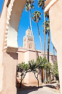 Koutoubia mosque with palms against clear blue sky, Marrakech.