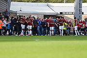 Northampton Towns Andy Williams(9) scores a goal 2-1 and celebrates with supporters who invade the pitch during the EFL Sky Bet League 2 match between Northampton Town and Forest Green Rovers at Sixfields Stadium, Northampton, England on 13 October 2018.