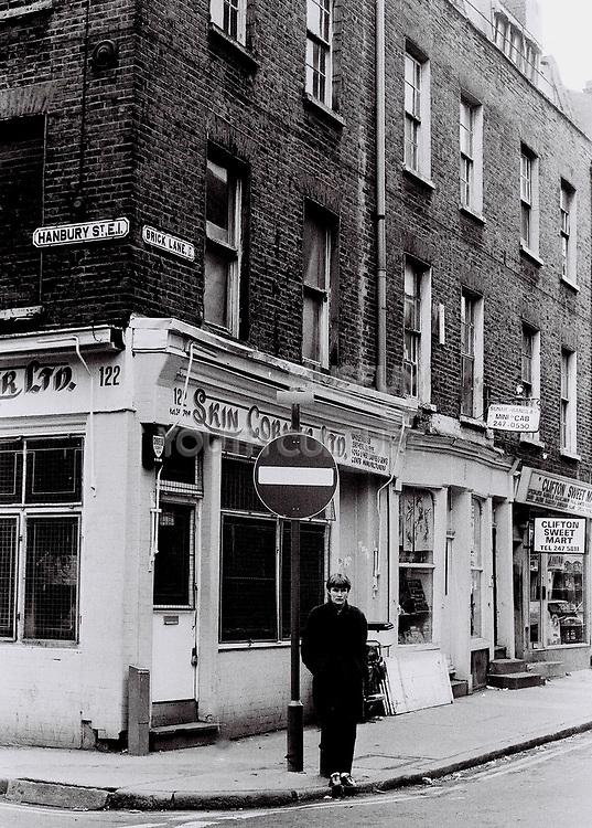 Teenager standing on street junction, London, UK, 1982