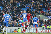 Brighton and Hove Albion midfielder Davy Propper (24) battles for a header with Swansea City midfielder Sung-Yueng Ki (4) during the Premier League match between Brighton and Hove Albion and Swansea City at the American Express Community Stadium, Brighton and Hove, England on 24 February 2018. Picture by Phil Duncan.