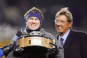 PITTSBURGH - JANUARY 23:  Head coach Bill Belichick of the New England Patriots holds the AFC Lamar Hunt Trophy on the postgame awards stage (with Joe Namath, right) after the Patriots win over the Pittsburgh Steelers in the AFC Championship game at Heinz Field on January 23, 2005 in Pittsburgh, Pennsylvania. The Pats defeated the Steelers 41-27. ©Paul Anthony Spinelli  *** Local Caption *** Bill Belichick; Joe Namath