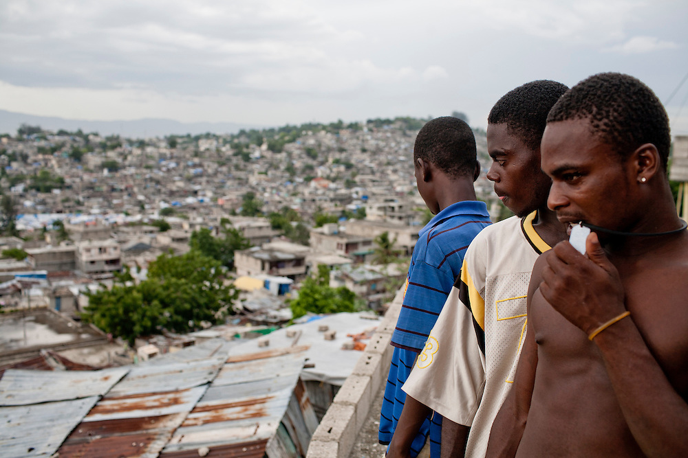 Men stand on a rooftop on July 13, 2010 in the Fort National neighborhood in Port-au-Prince, Haiti.