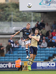 Millwall's Martyn Woolford beats Leeds United's Luke Murphy to the ball - Photo mandatory by-line: Robin White/JMP - Tel: Mobile: 07966 386802 28/09/2013 - SPORT - FOOTBALL - The Den - Millwall - Millwall V Leeds United - Sky Bet Championship