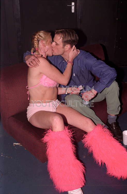 Two clubbers kissing on a sofa, Passion, Emporium, Milton Keynes, UK, 2002