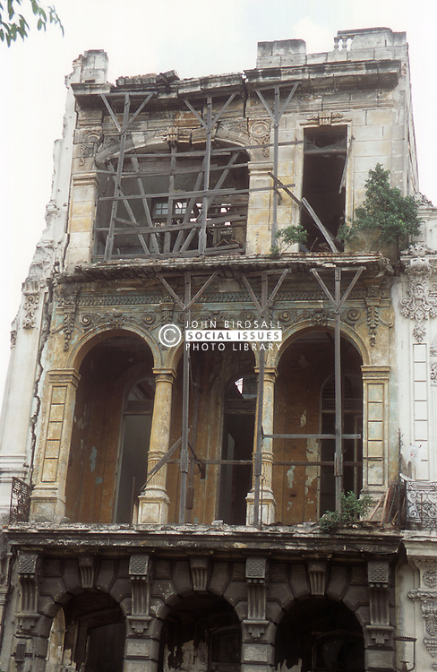Ancient building on the point of collapse in Havana; Cuba; being supported by wooden supports,