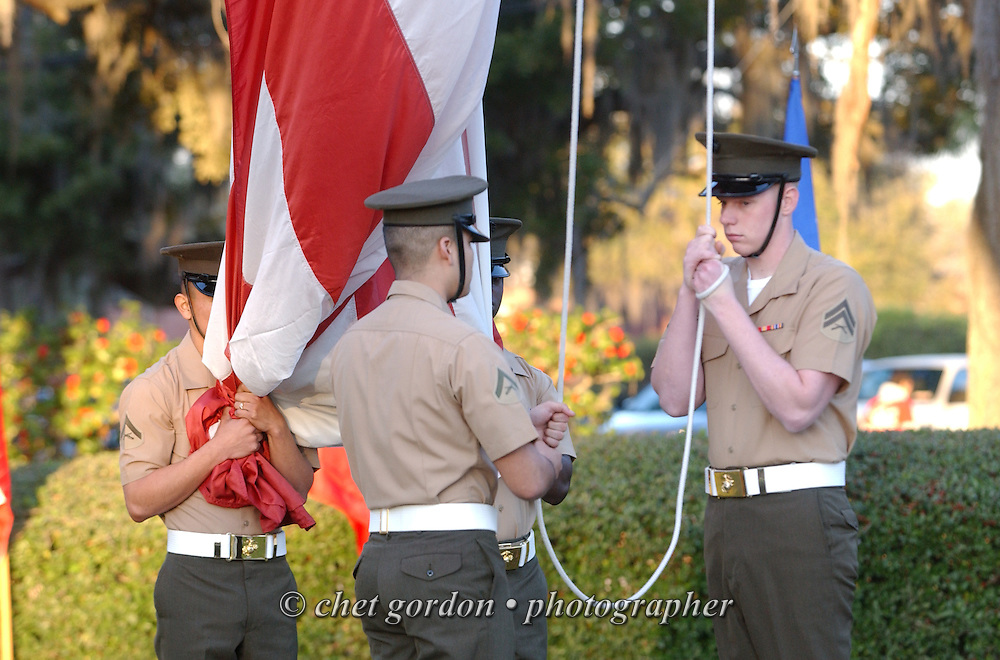 Marine color guard unfurls the American flag during the morning flag raising ceremony outside the Commanding General's headquarters at the Marine Corps Recruit Depot (MCRD) in Parris Island, SC on Friday, March 15, 2013.