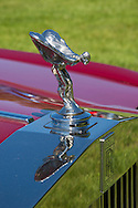 Westbury, New York, USA. June 12, 2016.  Flying Lady chrome hood ornament is atop grille of 1985 red Rolls Royce Silver Spur, owned by John Shorter, on display at the Antique and Collectible Auto Show at the 50th Annual Spring Meet at Old Westbury Gardens, in the Gold Coast of Long Island, and sponsored by Greater New York Region, GNYR, Antique Automobile Club of America, AACA. Participating vehicles in the judged show included hundreds of domestic and foreign, antique, classic, collectible, and modern cars.