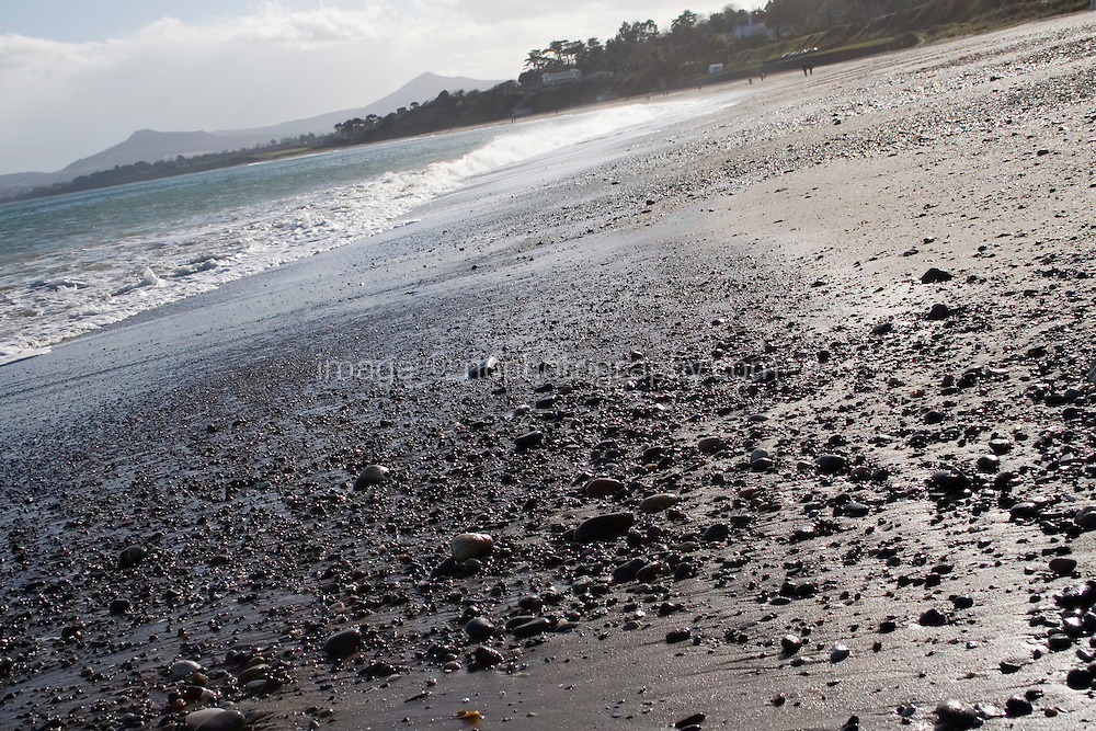 Angled view of winter sunlight on Killiney Beach in Dublin Ireland in the winter