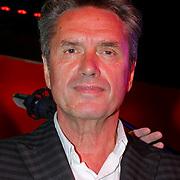 NLD/Amsterdam/20120918 - Cd Box presentatie Doe Maar , Henny Vrienten met de Cd /Dvd box
