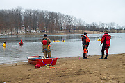 The Albany Fire Department takes safety precautions before the annual Polar Plunge at Lake Snowdon.