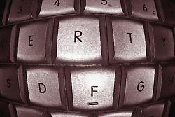 a computer keyboard fisheye effect in sepia tone