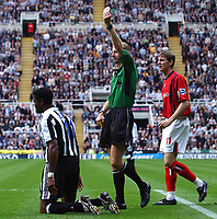 Photo: Back Page Images. 25/09/2004.<br /> Barclays Premiership. Newcastle United v W.B.A.<br /> Mike Riley gives Darren Purse the Birmingham captain his marching orders