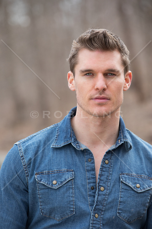 portrait of a good looking man with blue eyes and brown hair