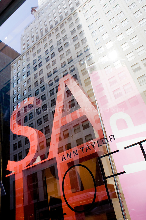 4 October, 2008. A sale sign in the window of the Ann Taylor-LOFT store of 42nd street and Lexington ave. As the financial crisis spread last month, many retailers hit the panic button, offering more generous discounts than they did at the same time last year. But the promotions did little to convince cautious shoppers to open their wallets.<br /> <br /> ©2008 Gianni Cipriano for The Wall Street Journal<br /> cell. +1 646 465 2168 (USA)<br /> cell. +1 328 567 7923 (Italy)<br /> gianni@giannicipriano.com<br /> www.giannicipriano.com