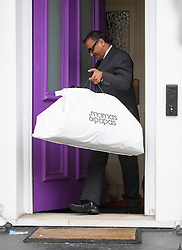 © Licensed to London News Pictures. 01/06/2016. London, UK. A 'mamas & papas' bag carrying baby items being taken from the London home of Rolling Stones guitarist Ronnie Wood, who turned 69 today (Weds) and had twins on May 30th with his wife Sally Humphreys.  Photo credit: Ben Cawthra/LNP
