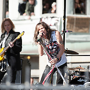 05 November 2012:  Aerosmith's Tom Hamilton and Steven Tyler perform a free concert in Boston's Allston neighborhood in front of the apartment building, 1325 Commonwealth Ave, which was the band's home in the early 1970's.  Boston, MA. ***Editorial Use Only*****