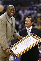 03 November 2005: Magic Johnson, formerly of the Los Angeles Lakers gives an award to Los Angeles Mayer Antonio Villaraigosa between the 1st and 2nd periods of the Phoenix Suns 122-112 victory over the Los Angeles Lakers at the STAPLES Center in Los Angeles, CA.