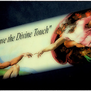 "Moving company logo on side of truck ""We Have the Divine Touch"" from Michelangelo's Sistine Chapel ceiling ofn the hand of god giving life to Adam"