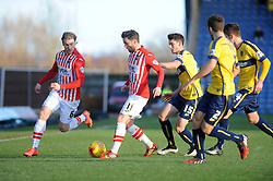 Exeter City's Arron Davies and Exeter City's Christian Ribeiro  take on the Oxford defence - Photo mandatory by-line: Neil Brookman/JMP - Mobile: 07966 386802 - 24/01/2015 - SPORT - Football - Oxford - Kassam Stadium - Oxford United v Exeter City - Sky Bet League Two