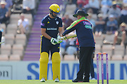 umpire Paul Baldwin uses the bat gauge to check Rilee Rossouw of Hampshire bat during the Royal London One Day Cup match between Hampshire County Cricket Club and Essex County Cricket Club at the Ageas Bowl, Southampton, United Kingdom on 23 May 2018. Picture by Dave Vokes.