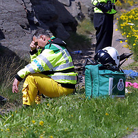 FILE PIC TO GO WITH DAVID CUNNINGHAM COURT CASE AT PERTH SHERIFF COURT.....A Paramedic at the scene of a double fatal crash on the A9, 3 miles south of Drumochter, between a mini-bus from Glasgow and a Landrover<br /><br />see story by Gordon Currie Tel: 01738 446766<br /><br />Pic by Graeme Hart<br />Copyright Perthshire Picture Agency<br />Tel: 01738 623350 / 07990 594431