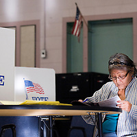 110612       Cable Hoover<br /> <br /> Mary Anne Peterson-Jimmie studies her ballot at the polling station in the Educational Development Center in Gallup Tuesday.