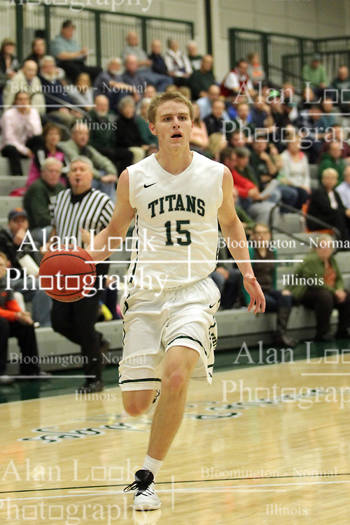 17 November 2015:  Brady Rose(15) brings the ball to the 3 point line looking for a shot or a team mate during an NCAA men's division 3 CCIW basketball game between the Greenville College Panthers and the Illinois Wesleyan Titans in Shirk Center, Bloomington IL