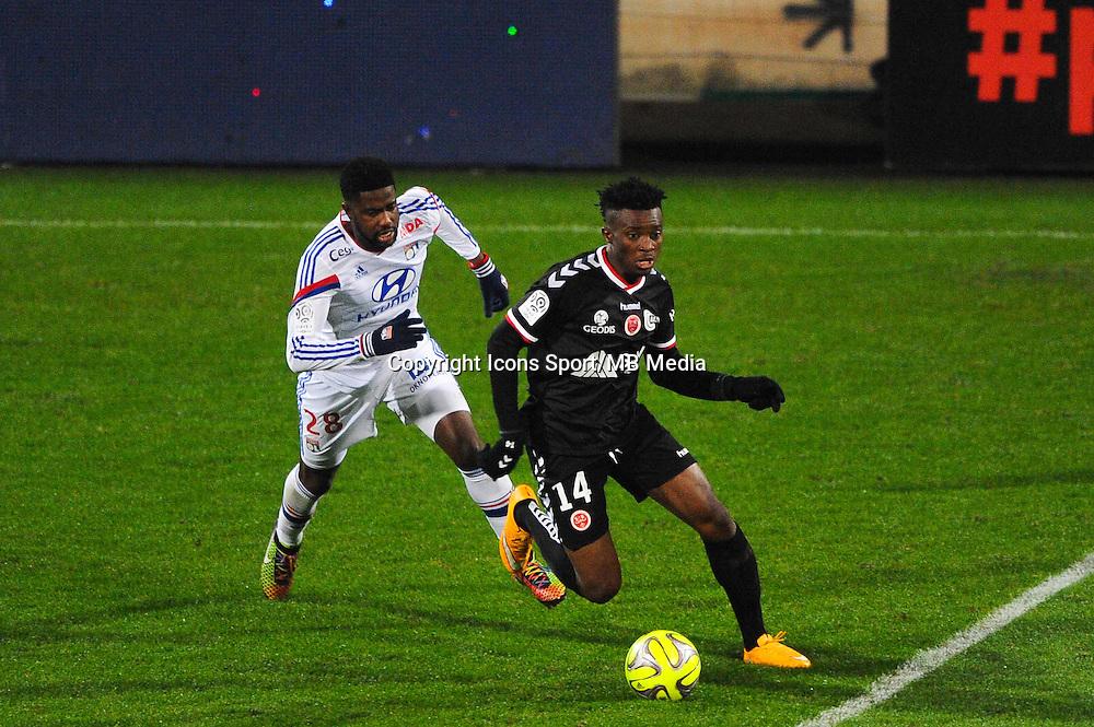 Benjamin MOUKANDJO  - 04.12.2014 - Lyon / Reims - 16eme journee de Ligue 1  <br /> Photo : Jean Paul Thomas / Icon Sport