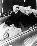 Presidents Herbert Hoover and Franklin Roosevelt ride together for the inauguration in Washington DC January 1932