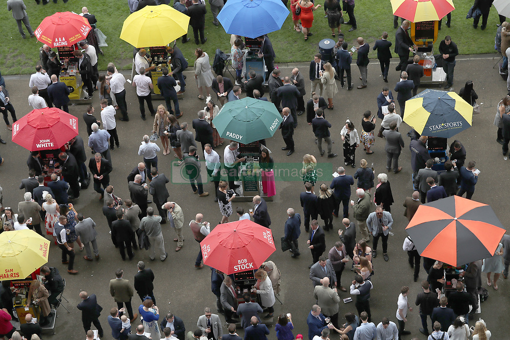 Racegoers and bookmakers during day two of King George VI Weekend at Ascot Racecourse, Berkshire.