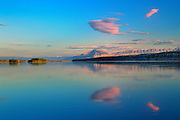 Clouds and Mackenzie Mountains at sunrise reflecting in the Liard River <br /> Liard Highway<br /> Northwest Territories<br /> Canada