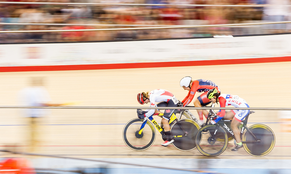 Jasmin Glassier (L) of Canada leads Sarah Hammer (C) of the United States and Denisse Ahumada of Chile in the<br />  women's cycling omnium elimination at the 2015 Pan American Games in Toronto, Canada, July 18,  2015.  AFP PHOTO/GEOFF ROBINS