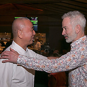 March 6, 2015, Indian Wells, California:<br /> John McEnroe is greeted by Nobu Matsuhisa in his restaurant, Nobu, during the McEnroe Challenge for Charity VIP Draw Ceremony in Stadium 2 at the Indian Wells Tennis Garden in Indian Wells, California Friday, March 6, 2015.<br /> (Photo by Billie Weiss/BNP Paribas Open)