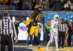Oct 25, 2018; Morgantown, WV, USA; West Virginia Mountaineers wide receiver David Sills V (13) catches a touchdown pass and celebrates with West Virginia Mountaineers wide receiver Dominique Maiden (82) during the second quarter against the Baylor Bears at Mountaineer Field at Milan Puskar Stadium. Mandatory Credit: Ben Queen-USA TODAY Sports