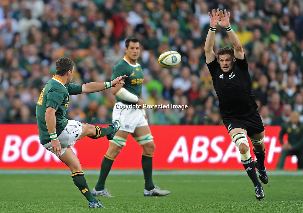 TRI-NATIONS 2010, FNB STADIUM in SOWETO, 21 August 2010. Richie McCaw (c) of the All Blacks tries to block a drop gaol from Morn&eacute; Steyn of the Springboks with Pierre Spies of the Springboks in the background during the Tri-Nations match between South Africa and New Zealand at the FNB Stadium in Soweto, Johannesburg, South Africa on 21 August 2010.<br /> Photographer : Anton de Villiers / PHOTOSPORT