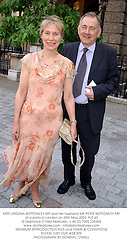 MRS VIRGINIA BOTTOMLEY MP and her husband MR PETER BOTTOMLEY MP at a party in London on 28th May 2003.PJZ 43