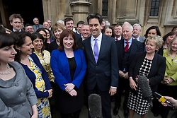 © licensed to London News Pictures. London, UK 08/05/2013. Labour's newest MP Emma Lewell-Buck (centre left) for South Shields, being welcomed by Ed Miliband and other Labour MPs at the House of Commons following her by-election victory last week. Photo credit: Tolga Akmen/LNP