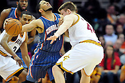 April 5, 2011; Cleveland, OH, USA; Charlotte Bobcats point guard D.J. Augustin (14) runs into Cleveland Cavaliers forward Luke Harangody (44) during the fourth quarter at Quicken Loans Arena. The Cavaliers beat the Bobcats 99-89. Mandatory Credit: Jason Miller-US PRESSWIRE