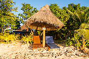 Beach loungers on the beach of Oarsman Bay, Yasawas, Fiji, South Pacific