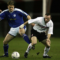 Clyde v St Johnstone..22.03.05<br />Ian Harty tackled by Ian Maxwell<br /><br />Picture by Graeme Hart.<br />Copyright Perthshire Picture Agency<br />Tel: 01738 623350  Mobile: 07990 594431