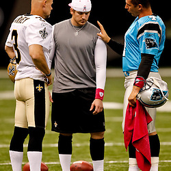 October 3, 2010; New Orleans, LA, USA; New Orleans Saints place kicker Garrett Hartley (left) gets instruction from kicker John Carney (3) and Carolina Panthers place kicker John Kasay (4) during warm ups prior to kickoff of a game between the New Orleans Saints and the Carolina Panthers at the Louisiana Superdome. Mandatory Credit: Derick E. Hingle