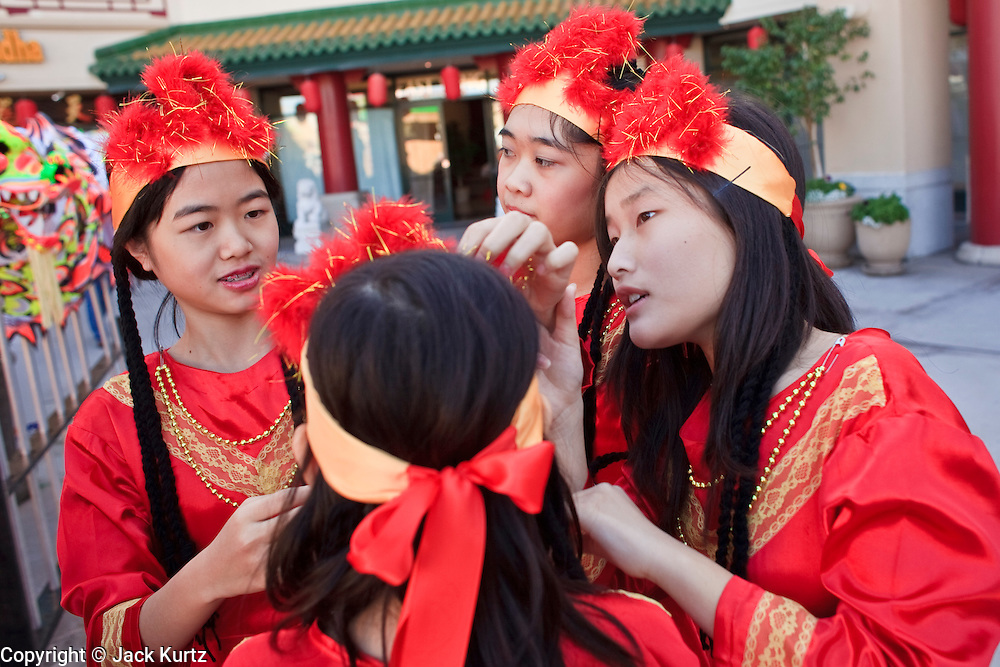"14 FEBRUARY 2010 - PHOENIX, AZ: Girls get ready to perform a traditional Chinese dance during Chinese New Year celebrations in Phoenix, AZ. This marks the Chinese ""Year of the Tiger."" The Chinese New Year Celebration at the COFCO Chinese Cultural Center in Phoenix attracted thousands of people. The celebration featured traditional Chinese entertainment and food.  PHOTO BY JACK KURTZ"