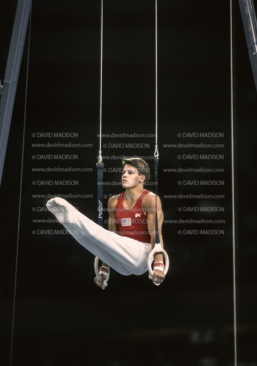 SEATTLE - JULY 1990:  Chris Waller of the United States performs on the still rings during the gymnastics competition of the 1990 Goodwill Games held from July 20 - August 5, 1990.  The gymnastics venue was the Tacoma Dome in Tacoma, Washington.  (Photo by David Madison/Getty Images)