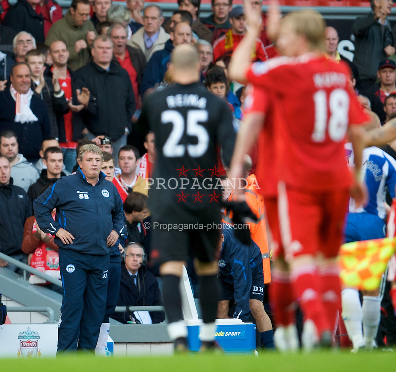 LIVERPOOL, ENGLAND - Saturday, October 18, 2008: Wigan Athletic's manager Steve Bruce looks dejected as Liverpool celebrate their 3-2 victory in the Premiership match against Wigan Athletic at Anfield. (Photo by David Rawcliffe/Propaganda)