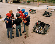 Pilots of the 'Red Arrows', Britain's Royal Air Force aerobatic team enjoy afternoon off from training on karting track.